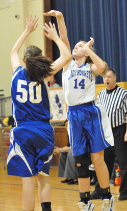 Riley Hill (14) follows through on her jumper. (Photo by Kevin Nagle)