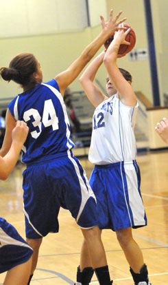 Sarah Kennedy (12) looks for room to get a shot away. (Photo by Kevin Nagle)