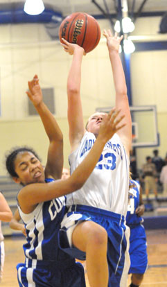 Kendal Rogers tries to finish off a drive to the basket. (Photo by Kevin Nagle)