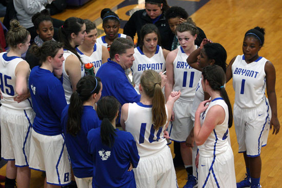 Bryant head coach Brad Matthews talks to his team during a timeout in Thursday's game. (Photo by Rick Nation)