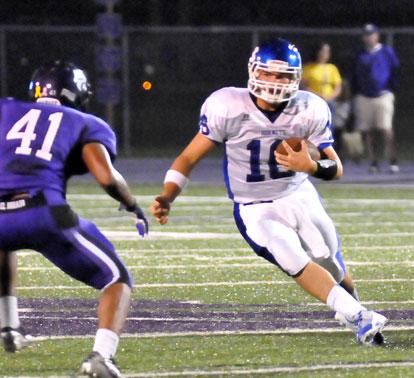 Hayden Lessenberry (16) scrambles to get past El Dorado linebacker Patrick Seweje. (Photo by Kevin Nagle)