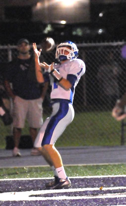 Austin Powell hauls in a pass for the first touchdown of Friday's game. (Photo by Kevin Nagle)