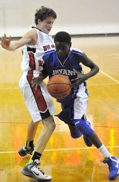Bryant's Kevin Hunt drives past a Vilonia defender. (Photo by Kevin Nagle)