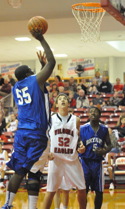 Cameron Murray (55) shoots over Vilonia's Charlie Thomas and Bryant's Quin Royal. (Photo by Kevin Nagle)