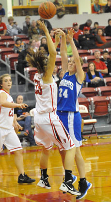 Britney Sahlmann shoots over Vilonia's Lauren Rappold. (Photo by Kevin Nagle)
