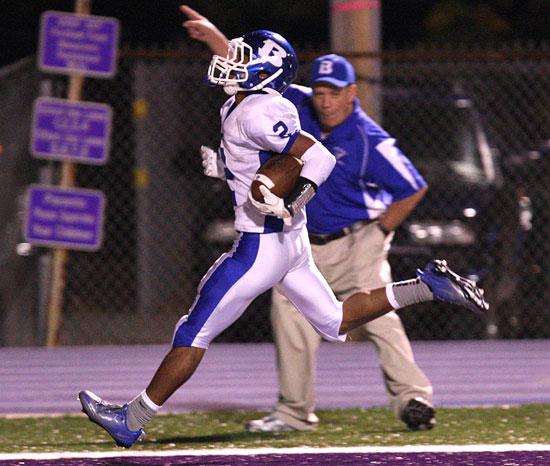 Bryant receiver Brushawn Hunter scores against El Dorado as Hornets fan and Bryant school board member Joe Wishard celebrates. (Photo by Rick Nation)