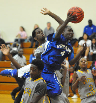 Simeon Rice attacks the basket, slicing through the Watson Chapel defense. (Photo by Kevin Nagle)