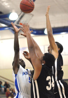 Kris Croom puts up a shot over a pair of Maumelle defenders. (Photo by Kevin Nagle)