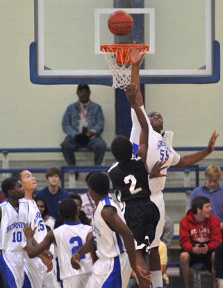 Cameron Murray (55) goes high to try to block the shot of Maumelle's Barry Nixon. (Photo by Kevin Nagle)