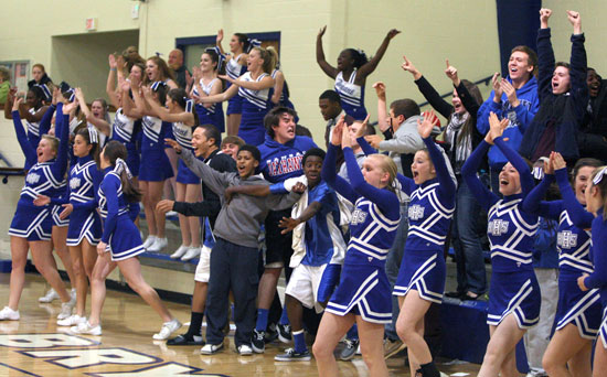 The Bryant freshman cheering section celebrates Kailey Nagle's shot with :10 left to play. (Photo by Rick Nation)
