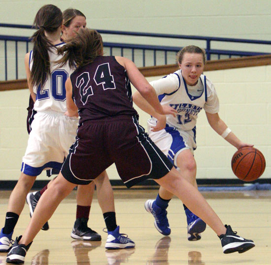 Bryant point guard Skyar Davis works around a screen set by teammate Kailey Nagle (20) as Benton's Jazmine Rodgers (24) defends. (Photo by Rick Nation)