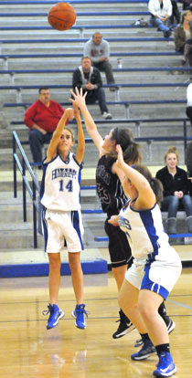Anna Lowery fires a shot from the baseline. (Photo by Kevin Nagle)
