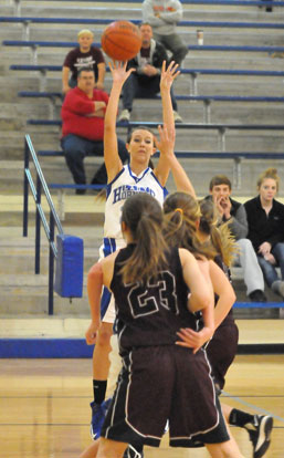 Kailey Nagle shoots over a pair of Benton defenders. (Photo by Kevin Nagle)