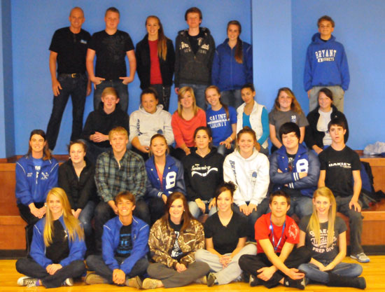 Olympian Rowdy Gaines, upper left, and the Bryant High School swim team. (Photo by Kevin Nagle)