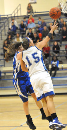 Peyton Ramsey (15) goes up for a shot. (Photo by Kevin Nagle)