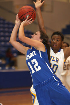 Madeleine Baxter (12) goes up for a shot in front of North Little Rock's Arbiniee Phillips. (Photo by Rick Nation)