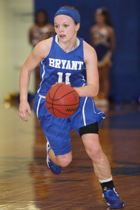Logan Davis pushes the ball up the floor. (Photo by Rick Nation)
