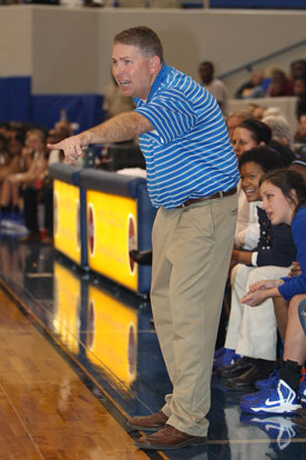 Bryant coach Brad Matthews directs traffic during Thursday's game. (Photo by Rick Nation)