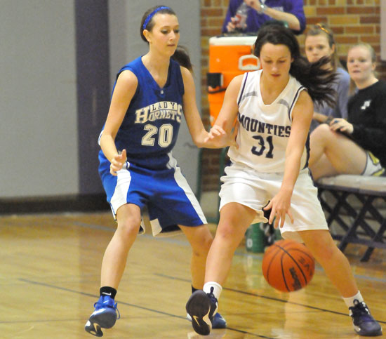 Bryant's Kailey Nagle (20) pressures a Mount St. Mary ballhandler. (Photo by Kevin Nagle)