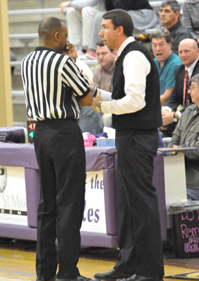 Bryant coach Nathan Castaldi discusses a call with one of the officials at Monday night's game. (Photo by Kevin Nagle)