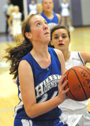 Bryant's Britney Sahlmann drives to the hoop. (Photo by Kevin Nagle)