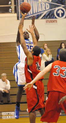 Greyson Giles launches a shot over Russellville's Dre Johnson. (Photo by Kevin Nagle)