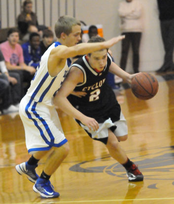 Bryant's John Winn (20) guards Russellville's Kregan Kordsmeier. (Photo by Kevin Nagle)