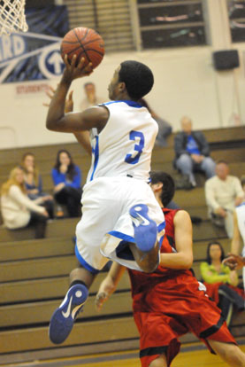 C.J. Rainey flies in for a layup. (Photo by Kevin Nagle)