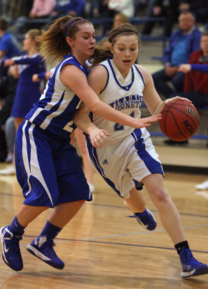Bryant's Annie Patton drives on Conway Blue's Heather Lumley. (Photo by Rick Nation)