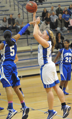 Anna Turpin fires up a shot over Conway Blue's Alexis Tolefree. (Photo by Kevin Nagle)