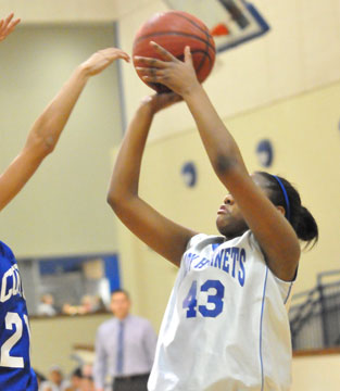 Deja Rayford launches a shot for Bryant White. (Photo by Kevin Nagle)