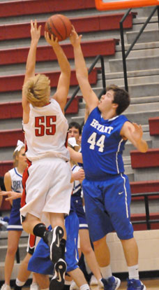 Zach Cambron (44) blocks a shot by Cabot's Brett Frazier. (photo by Kevin Nagle)