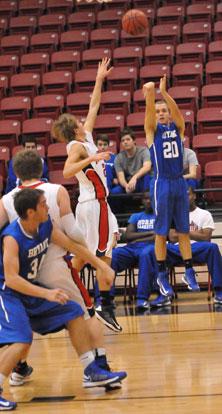 John Winn (20) tries a 3 from the corner. (Photo by Kevin Nagle)