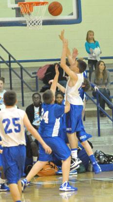 Grayson Prince (42) tries to score over Bryant Blue's Preston Kyzer (34). (Photo by Kevin Nagle)