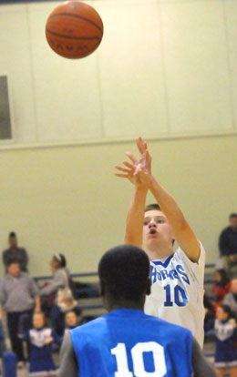 Bryant White's Jake East fires up a shot over Blue's Caylin Allen. (Photo by Kevin Nagle)