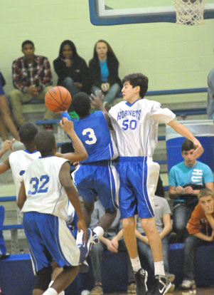 Bryant White's Kyle Sahr (50) goes up to try to block a shot by Calvin Allen (3). (PHoto by Kevin Nagle)