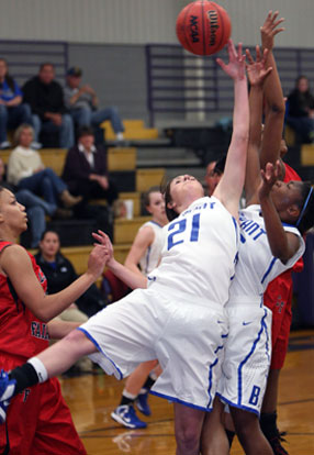 Courtney Davidson (21) and Dezerea Duckworth battle for a rebound during Thursday's game against Camden Fairview at CAC. (Photo by Rick Nation)