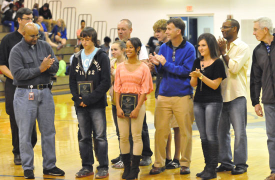 Connor Wilson and Melinda Murdock, supported by their parents, receive Athlete of the Month plaques from Sykes Representative Calvin Naylor. (Photo by Kevin Nagle)
