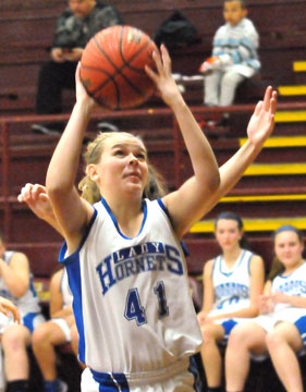 Hailey Gentry eyes the basket. (Photo by Kevin Nagle)