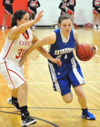 Bryant's Annie Patton tries to drive around a Cabot South defender. (Photo by Kevin Nagle)
