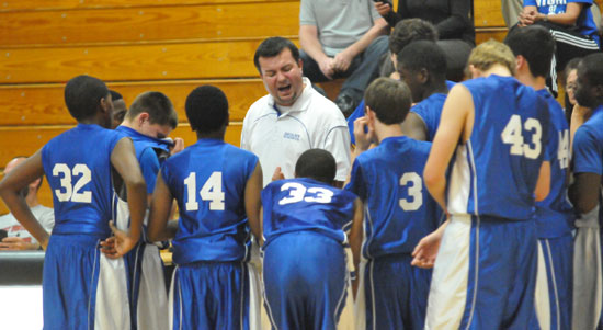 Bryant White coach Heath Long makes a point with his team during a timeout. (Photo by Kevin Nagle)