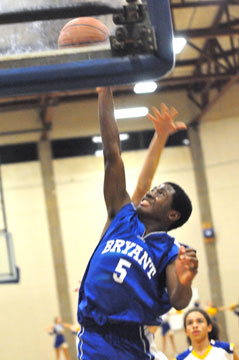 Kris Croom goes high to get a shot away. (photo by Kevin Nagle)
