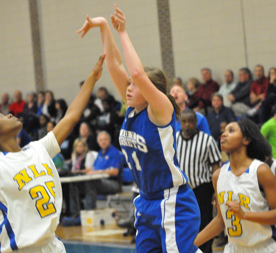 Annie Patton launches a shot between a pair of North Little Rock defenders. (Photo by Kevin Nagle)