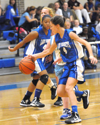 Hadley Dickinson (4) makes a steal. (Photo by Kevin Nagle)