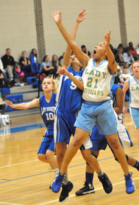 Bryant White's Alyssa Kubaiko (5) defends against a Lakewood shooter. (Photo by Kevin Nagle)