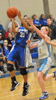 Destiny Martin goes up for a shot. (Photo by Kevin Nagle)