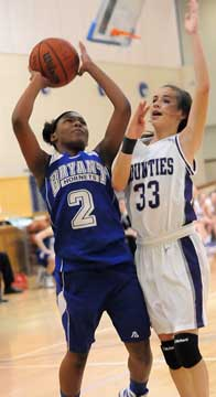 Bryant's Jayla Anderson (2) shoots over Mount St. Mary's Morgan Payne (33). (Photo by Kevin Nagle)