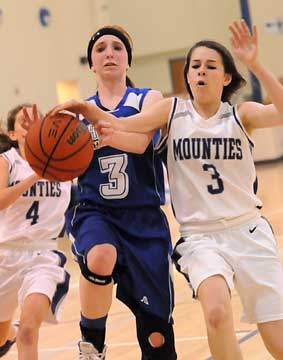 Bryant's Nikki Clay (3, left) gets fouled. (photo by Kevin Nagle)