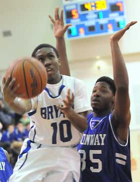 Bryant's Anthony Black (10) scoops up a shot against Xavier Clardy. (Photo by Kevin Nagle)