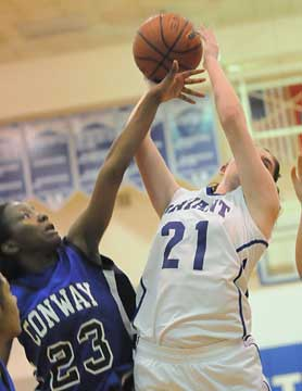 Courtney Davidson (21) reaches for a rebound. (Photo by Kevin Nagle)